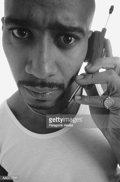 Concerned Man Using a Cellular Phone