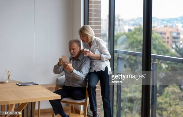 concerned senior couple at home going online on a tablet computer - diabetic amputation stock pictures, royalty-free photos & images
