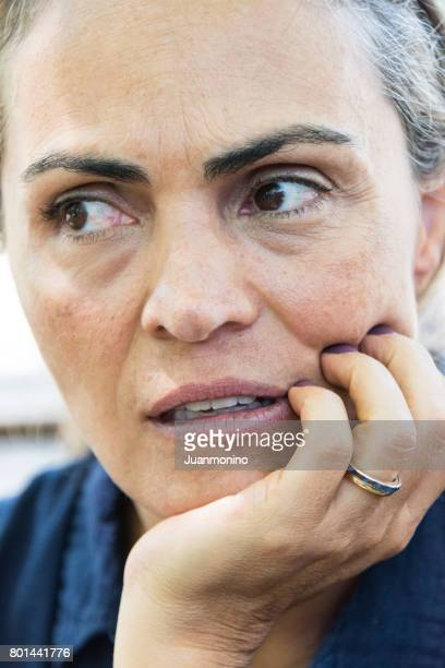 Concerned serious mature woman