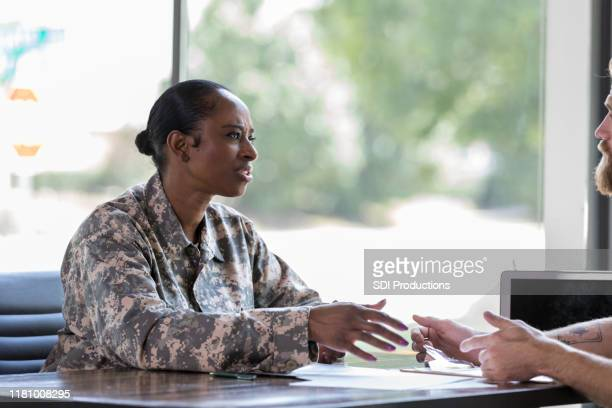concerned veteran talks with therapist - post traumatic stress disorder stock pictures, royalty-free photos & images