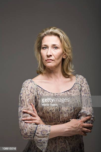 Concerned woman with arms crossed