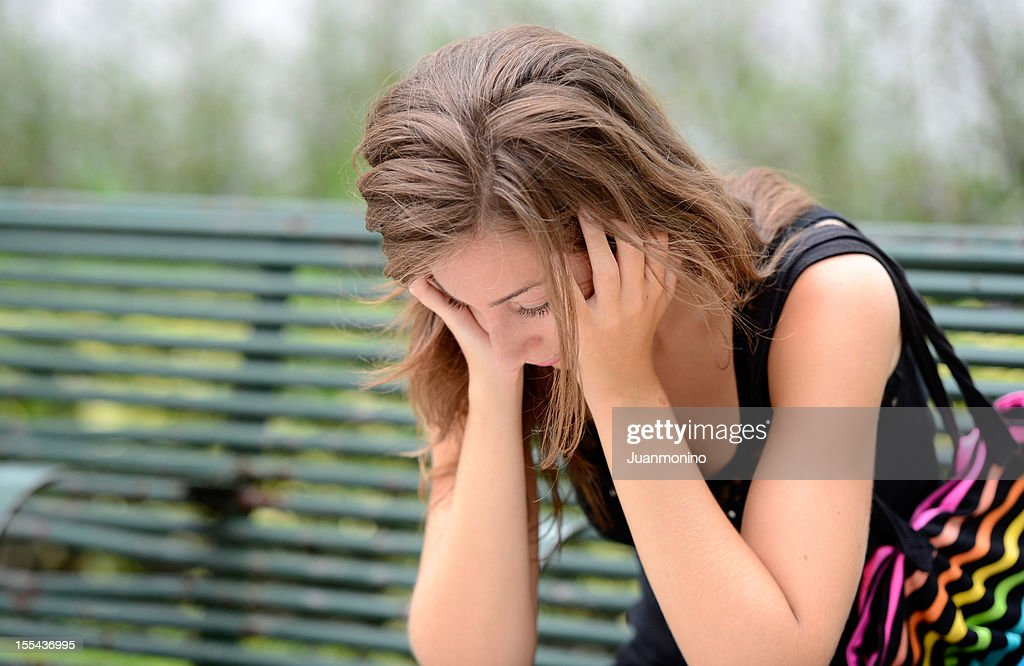 Concerned young woman : Stock Photo