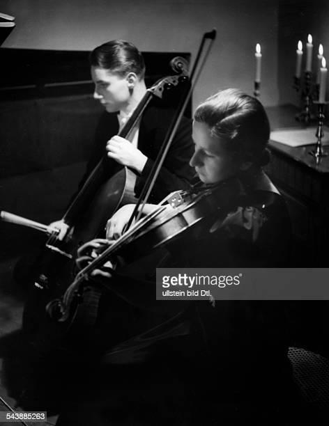Concert at the house of professor Eta Margarethe HarichSchneider ca 1939 Photographer Hedda Walther Published by 'Die Dame' 23/1939Vintage property...