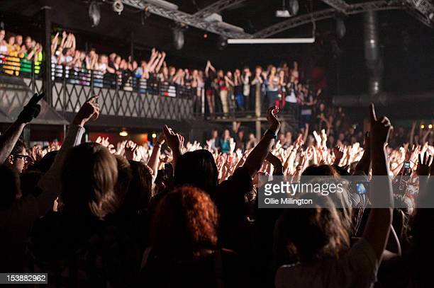 Concert attendees as The Midnight Beast perform on stage during a date of the 'I kicked a tour in the face' tour at Rock City on October 10 2012 in...