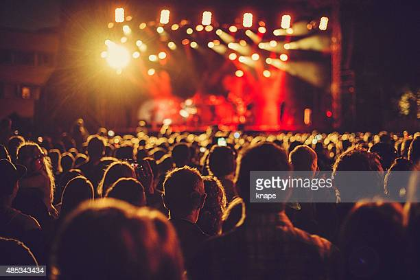 concert audience listening to music - saturated colour stock pictures, royalty-free photos & images