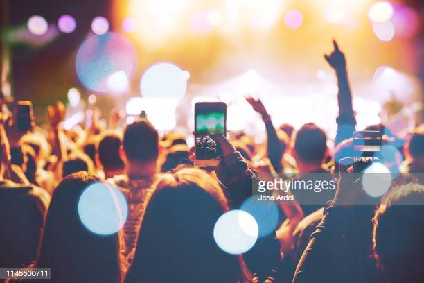 concert cellphone, concert cell phone, concert cell phones, concert crowd - rock music stock pictures, royalty-free photos & images