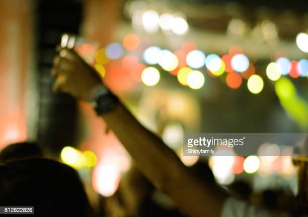 Concert crowd at live music festival. Unrecognizable person.