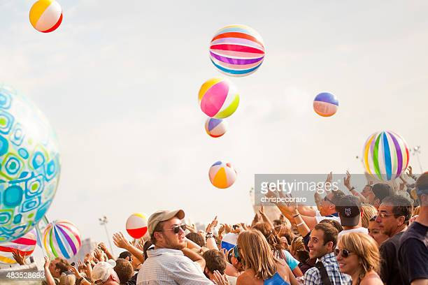 concert crowd at summer music festival - bouncing ball stock photos and pictures