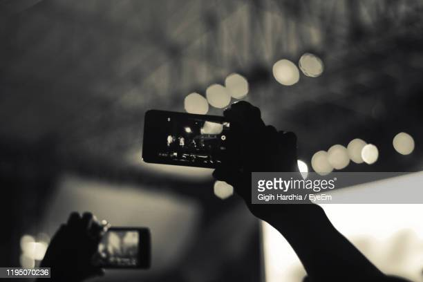 concert crowd filming with smartphone - モバイル撮影 ストックフォトと画像