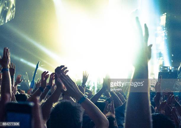 concert crowd, hands in the air - brightly lit stock photos and pictures
