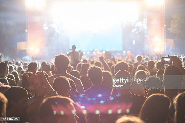 concert crowd - stage performance space stock photos and pictures