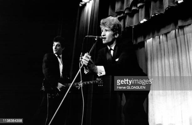 Concert du chanteur français Eddy Mitchell avec son groupe les Chaussettes noires, en 1961.