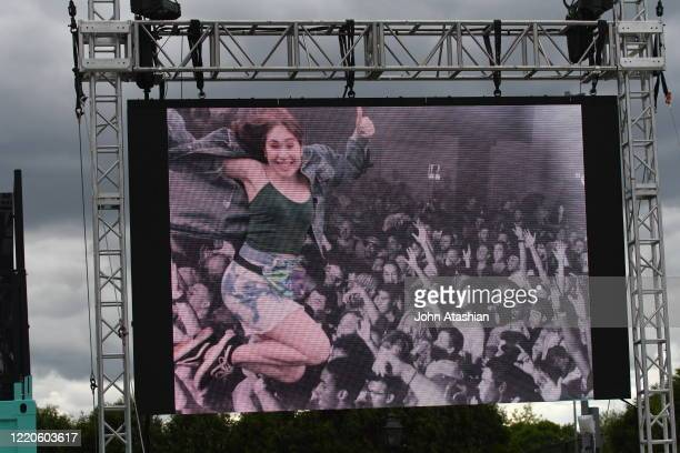 Concert fans is shown stage diving on a giant screen during the Boston Calling music festival on May 24, 2019.