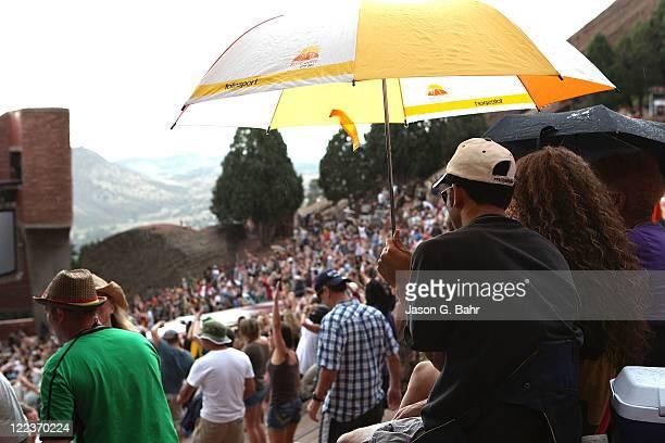 Concert goers fend off the light rain while enjoying the Reggae on the Rocks music festival at Red Rocks Amphitheater on August 27 2011 in Morrison...