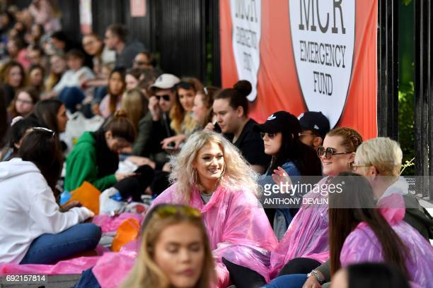 Concert goers queue outside Old Trafford Cricket Ground ahead of the One Love Manchester tribute concert in Manchester on June 4 2017 Nearly two...