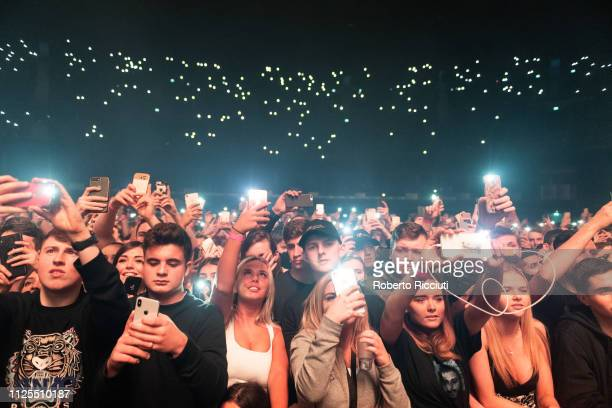 Concert goers with their lit up mobile phones during Post Malone concert at The SSE Hydro on February 17 2019 in Glasgow Scotland