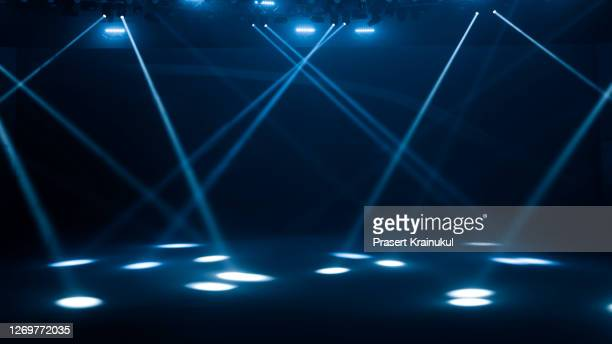 concert lighting on black abstract background - igniting stock pictures, royalty-free photos & images
