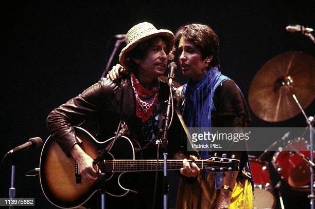 Concert of Bob and Santana in Hamburg Germany on June 05 1984Joan Baez in concert with Bob Dylan on stage
