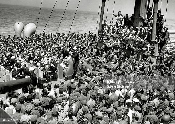 Concert of jazz, bebop and swing on the deck of a U.S. Ship. July 1944. There are soldiers of the 82nd Airborne Division and the 101st Infantry...