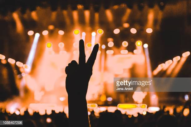 concert peace sign - concert hall stock pictures, royalty-free photos & images