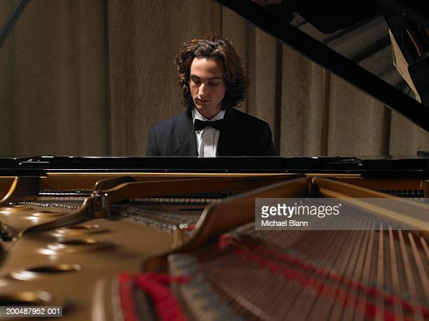 Concert pianist playing grand piano