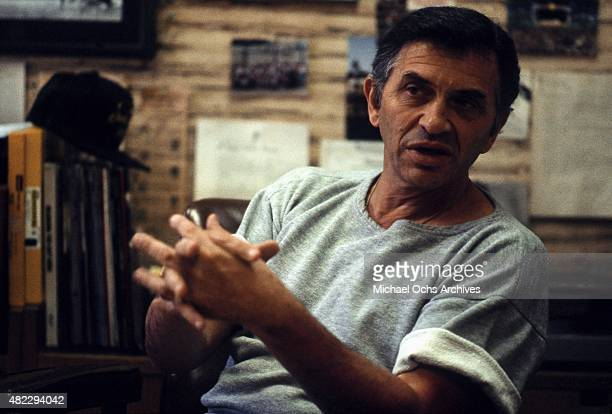 Concert promoter Bill Graham poses for a portrait in his office on April 7, 1984 in San Francisco, California.