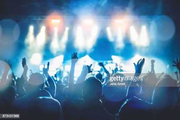 concert stage and concert audience - filter band stock photos and pictures