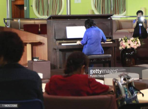 A concert using a piano played by Akiko Kawamoto a 19yearold Japanese woman killed in the 1945 US atomic bombing of Hiroshima is held on a ship off...