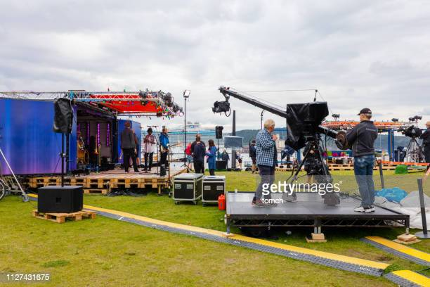 concert video shooting near the building of the museum of modern art in oslo - backstage stock pictures, royalty-free photos & images