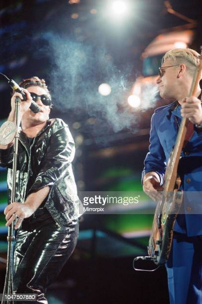 Concert, Zoo TV Tour, Cardiff Arms Park, Cardiff, Wales, Wednesday 18th August 1993, picture shows lead singer Bono and bass guitarist Adam Clayton...
