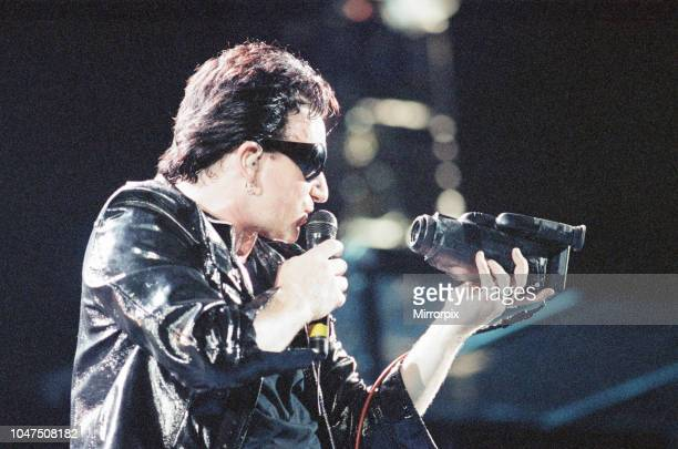 Concert, Zoo TV Tour, Cardiff Arms Park, Cardiff, Wales, Wednesday 18th August 1993, picture shows lead singer Bono on stage with camcorder.