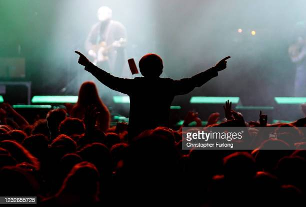 Concert-goer enjoys a non-socially distanced outdoor live music event at Sefton Park on May 2, 2021 in Liverpool, England. The event is part of the...
