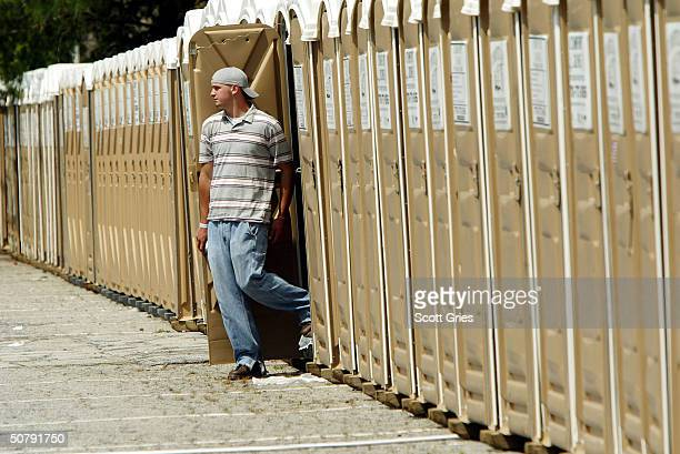 A concertgoer exits one of the many portable toilets at Music Midtown May 1 2004 in Atlanta Georgia