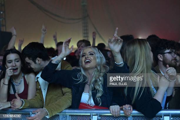 Concert-goers dance to music at the venue for the latest event in the government's Events Research programme, a live music concert hosted by Festival...