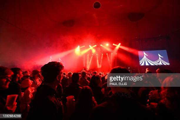 Concert-goers dance to music from DJ Zuzu at the venue for the latest event in the government's Events Research programme, a live music concert...