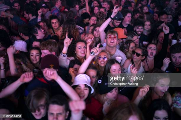 Concert-goers enjoy a non-socially distanced outdoor live music event at Sefton Park on May 2, 2021 in Liverpool, England. The event is part of the...