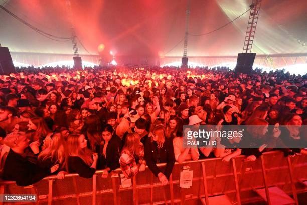 Concert-goers wait to dance to music at the venue for the latest event in the government's Events Research programme, a live music concert hosted by...