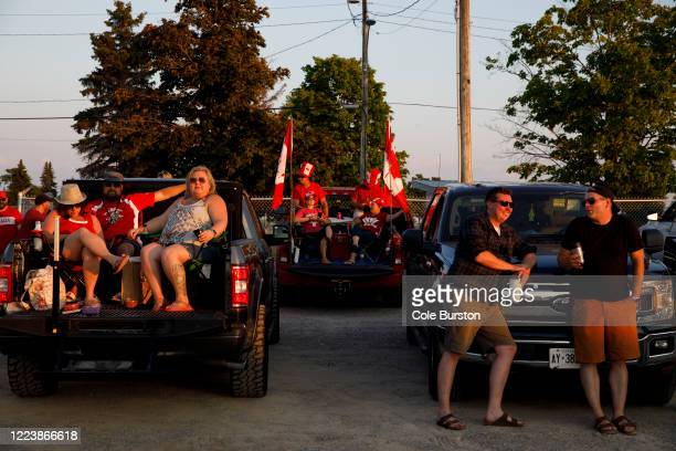Concert-goers watch from their vehicles during a drive-in Dean Brody concert to celebrate Canada Day on July 1, 2020 in Markham, Canada. While most...