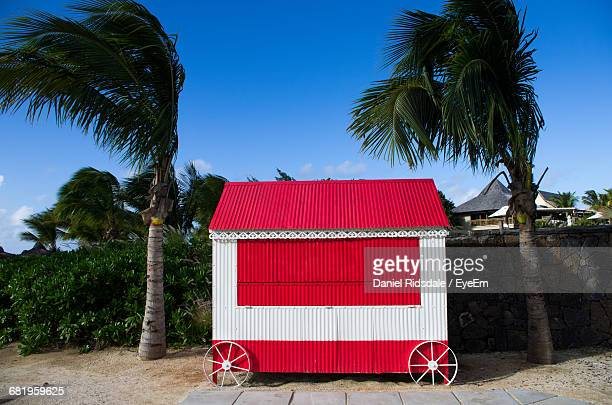concession stand by palm trees against sky at beach - kiosk stock pictures, royalty-free photos & images