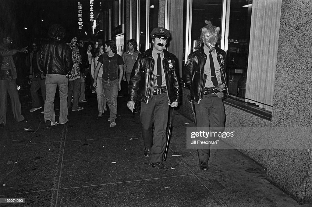 A concession to Hallowe'en from officers of the 9th Precinct in New York City, circa 1978.