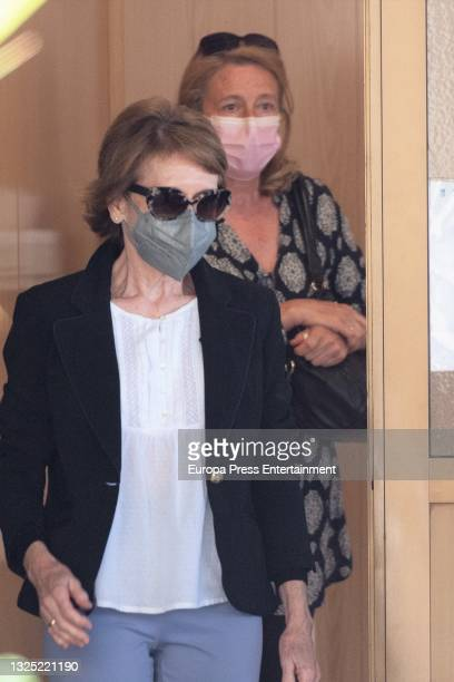 Concha and Encarna Ximenez leave the mortuary of the M-30, on June 24 in Madrid, Spain.
