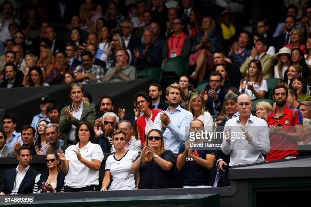 Conchita Martinez coach of Garbine Muguruza applauds her Ladies Singles final against Venus Williams of The United States on day twelve of the...