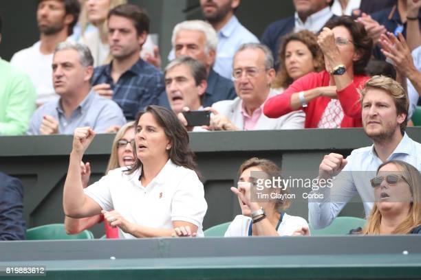 Conchita Martinez coach of Garbine Muguruza of Spain celebrates a break of serve while in the family box during the Ladies Singles final against...