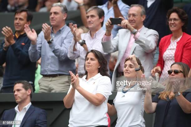 Conchita Martinez, coach of Garbine Muguruza of Spain, , celebrates a break of serve while in the family box during the Ladies Singles final against...