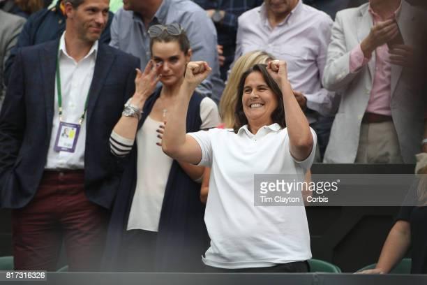 Conchita Martinez, coach of Garbine Muguruza of Spain, , celebrates her victory while in the family box during the Ladies Singles final against Venus...