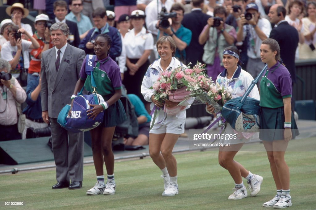 Conchita Martinez of Spain (2nd right) and Martina Navratilova of the USA (centre) courtseying to the Royal Box on Centre Court ahead of the Women's Singles Final of the Wimbledon Lawn Tennis Championships at the All England Lawn Tennis and Croquet Club, on July 2, 1994 in London, England. On the left is Referee Alan Mills.