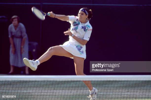 Conchita Martinez of Spain in action during the Wimbledon Lawn Tennis Championships at the All England Lawn Tennis and Croquet Club circa June 1994...