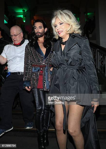 Conchita Wurst and Amanda Lear at 'THE ONE Grand Show' premiere at FriedrichstadtPalast on October 6 2016 in Berlin Germany