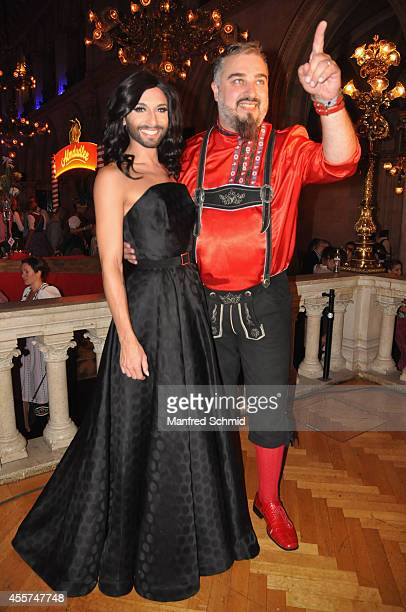 Conchita Wurst and Georgij Alexandrowitsch Makazaria of Russkaja pose for a photograph during the Trachtenpaerchenball 2014 at City Hall on September...