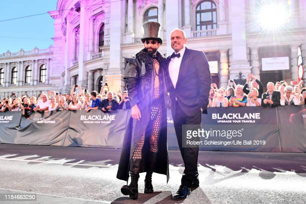 Conchita Wurst and Gery Keszler arrive for the Life Ball 2019 at City Hall on June 08, 2019 in Vienna, Austria. After 26 years the charity event Life...
